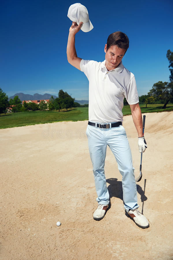 Frustrated golfer royalty free stock image