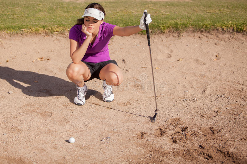 Frustrated golfer in a sand trap stock photos