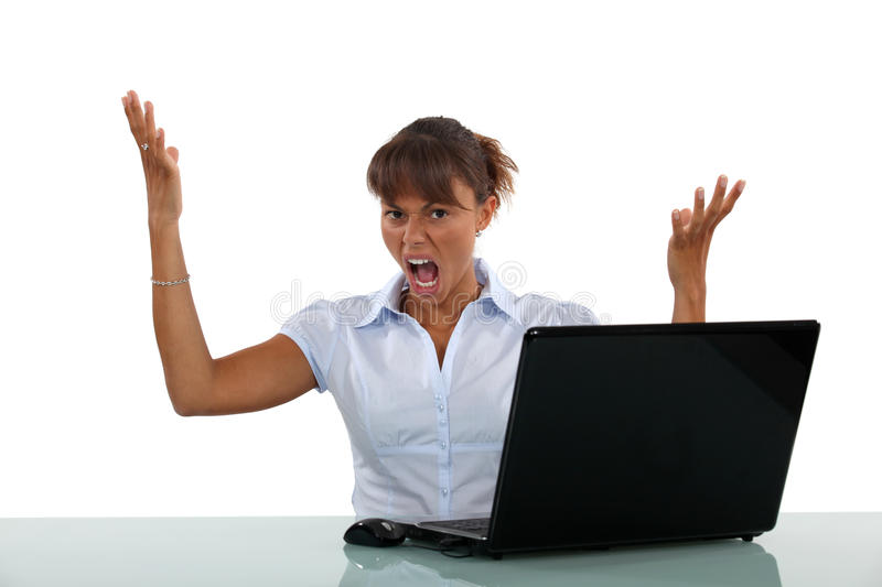 Frustrated with her laptop. Businesswoman frustrated with her laptop royalty free stock images