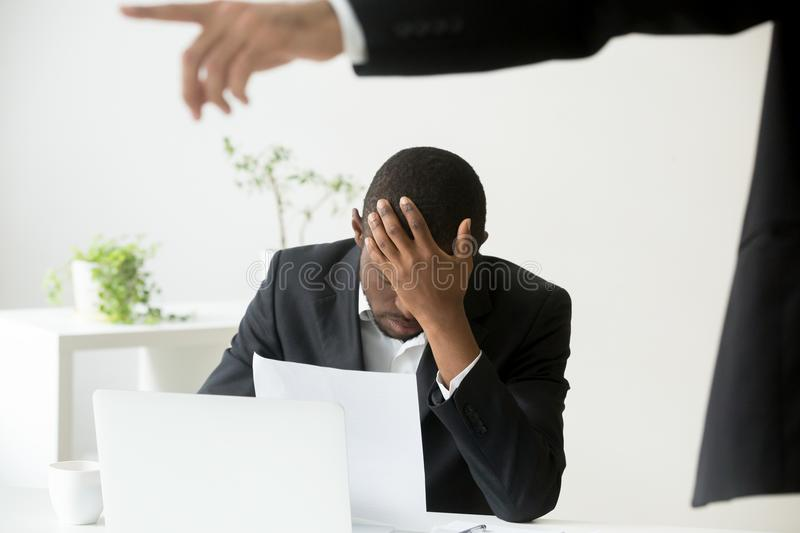 Frustrated hopeless african-american office worker getting fired royalty free stock images