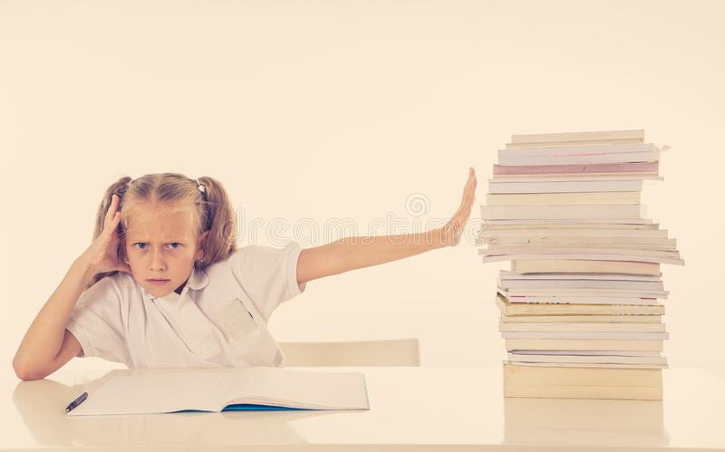 Frustrated little schoolgirl feeling a failure unable to concentrate in reading and writing difficulties learning problem stock photos