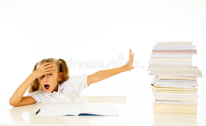 Frustrated little schoolgirl feeling a failure unable to concentrate in reading and writing difficulties learning problem royalty free stock image