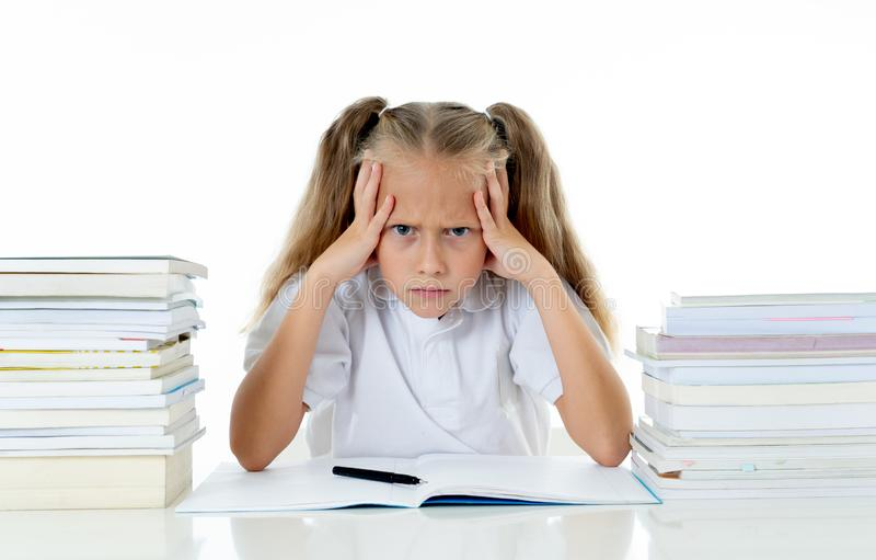 Frustrated little schoolgirl feeling a failure unable to concentrate in reading and writing difficulties learning problem stock images