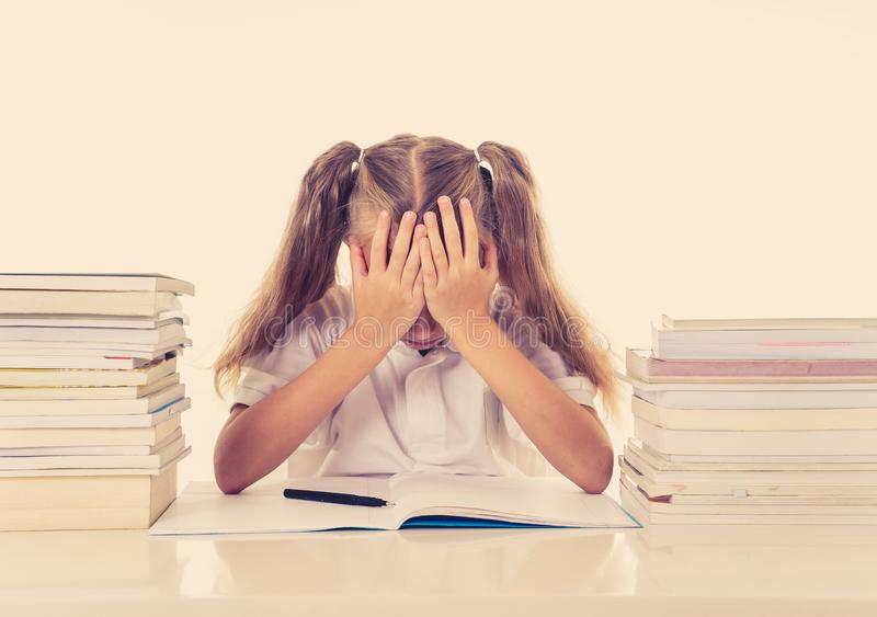 Frustrated little schoolgirl feeling a failure unable to concentrate in reading and writing difficulties learning problem royalty free stock photos