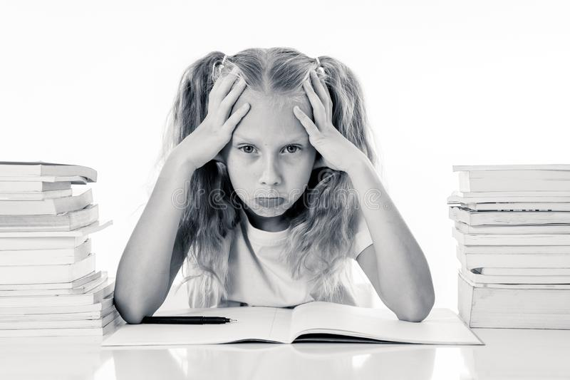 Frustrated little schoolgirl feeling a failure unable to concentrate in reading and writing difficulties learning problem stock photography