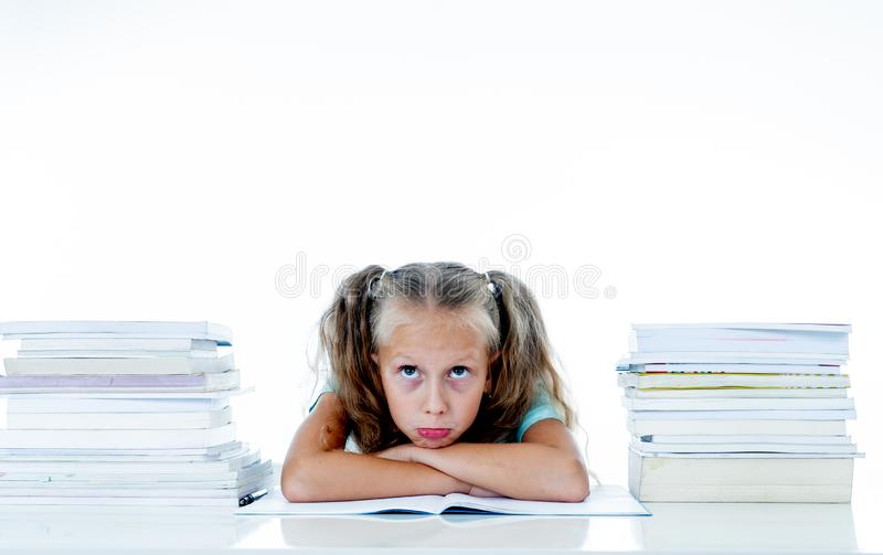 Frustrated little schoolgirl feeling a failure unable to concentrate in reading and writing difficulties learning problem. Attentional disorders special needs royalty free stock photo