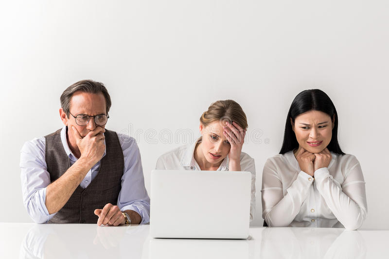 Frustrated man and women working on gadget royalty free stock photography