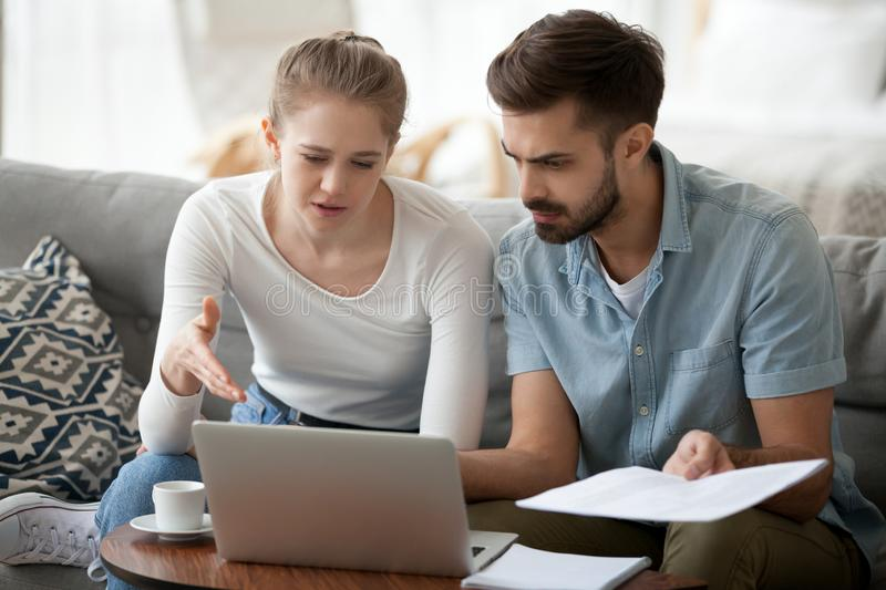 Frustrated married couple has financial problems received bad ne stock photo