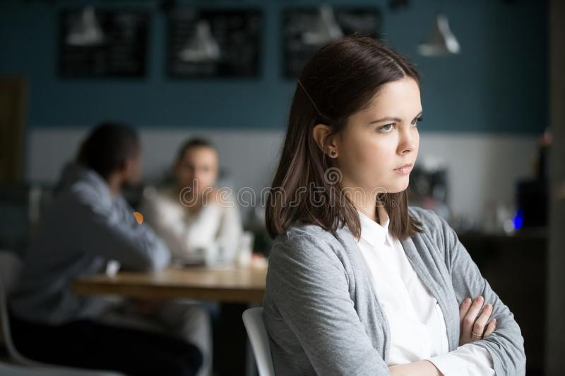 Frustrated millennial woman having no friends sitting alone in c. Offended frustrated millennial women feeling upset suffering from loneliness having no friends royalty free stock image