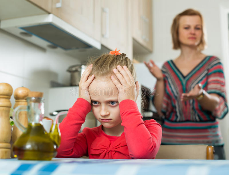 Frustrated mother scolding little daughter royalty free stock images