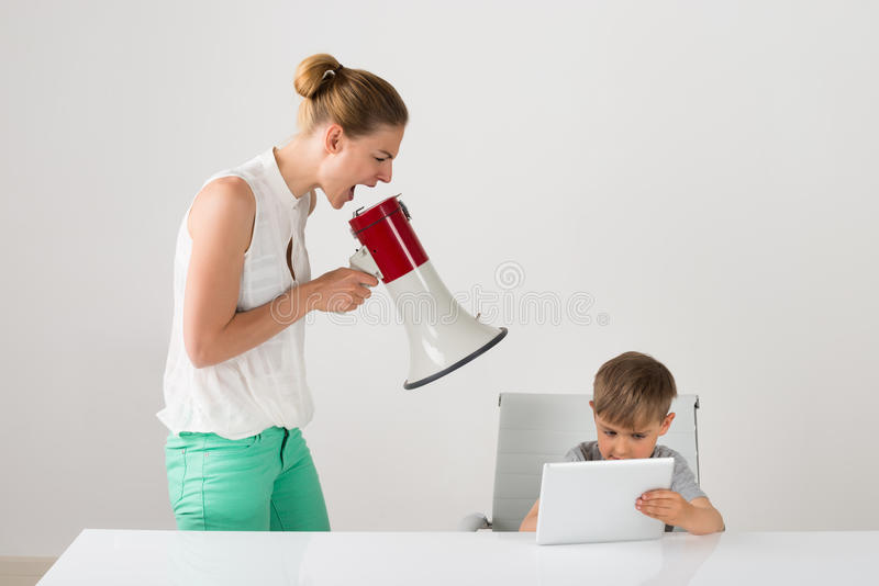 Frustrated Mother Shouting At Her Boy royalty free stock photo