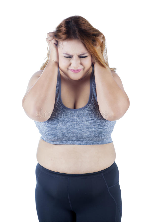 Frustrated overweight woman in studio royalty free stock photo