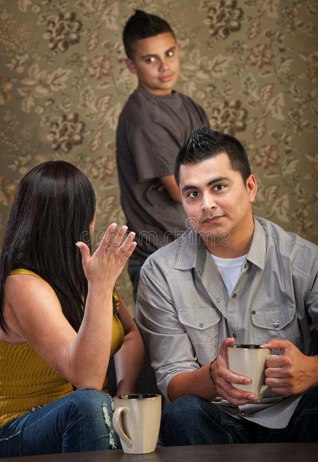 Frustrated Parents. Frustrated mother and father with teen child stock photos