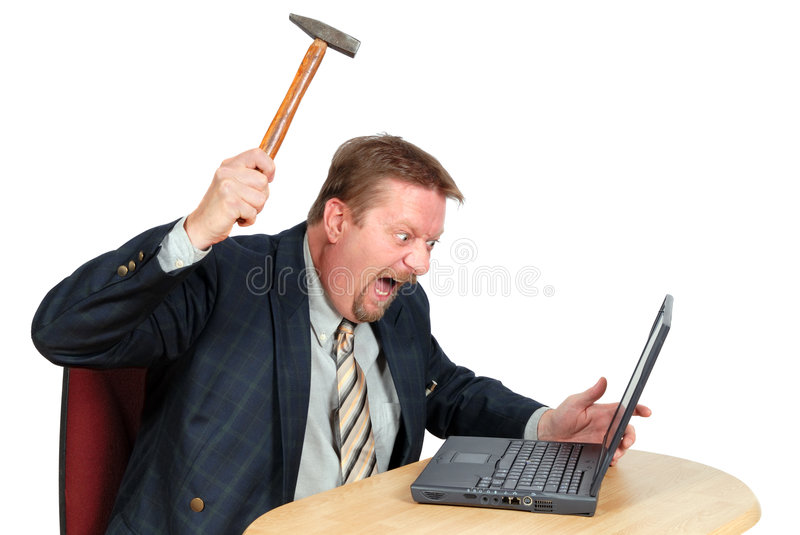 Frustrated PC user. Fustrated user or businessman in his office threatening to destroy his PC with a hammer out of sheer frustration for malfunctions, faulty or