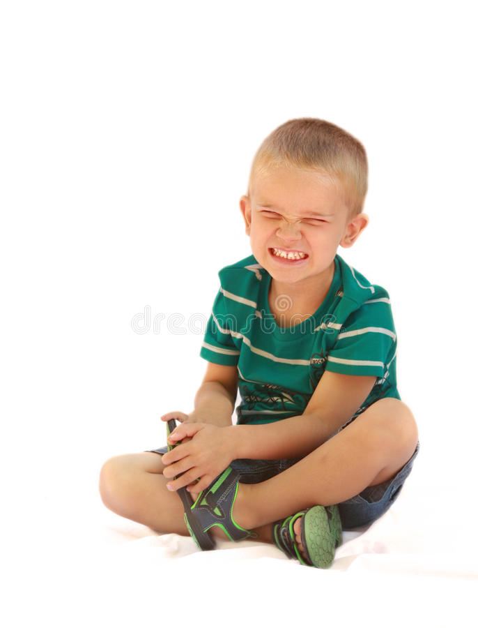 Frustrated Preschooler. Preschool aged boy with a frustrated or angry expression on his face, sitting on a white background royalty free stock photos