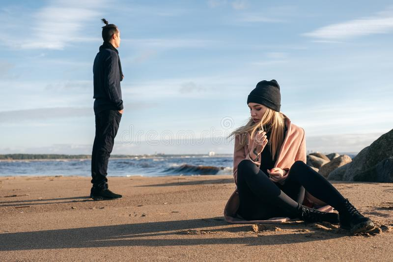 Frustrated sad girlfriend sit on sand think of relationship problems. royalty free stock photography