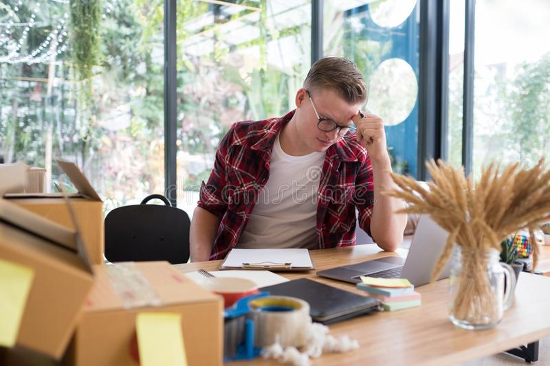 Frustrated startup small business owner working at workplace. st royalty free stock image