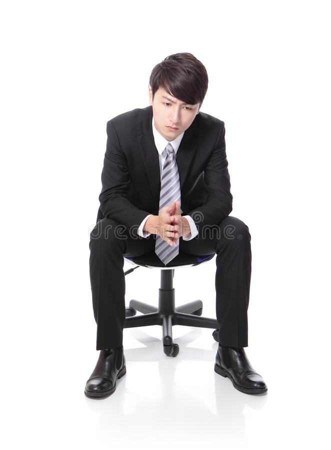 Frustrated and thinking business man sitting royalty free stock images