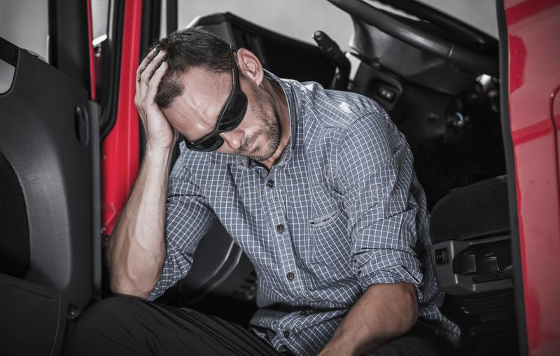 Frustrated Truck Driver. Frustrated Caucasian Semi Truck Driver Having Problem with His Truck and Job royalty free stock photo