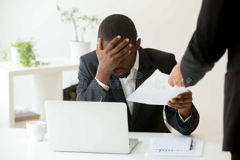Frustrated upset african american employee receiving dismissal n royalty free stock image
