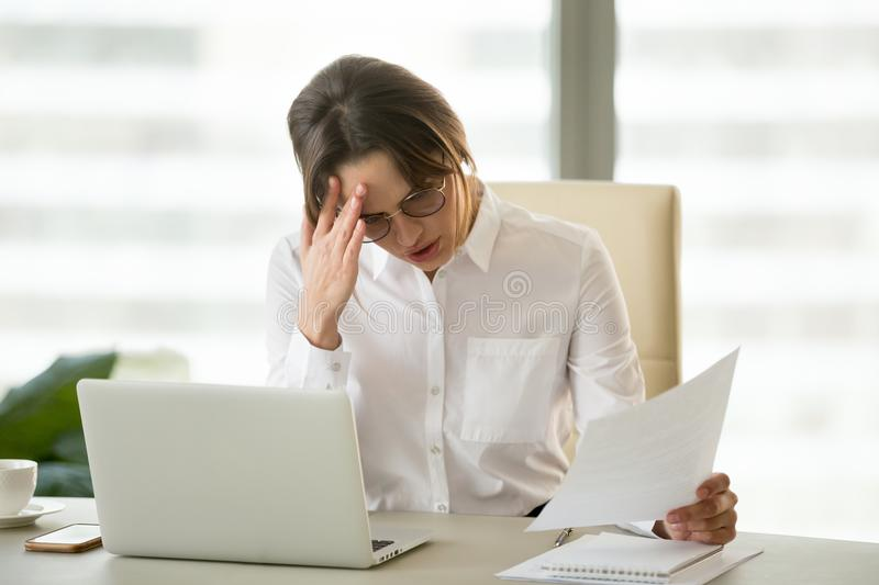 Frustrated upset businesswoman holding dismissal notice shocked stock images