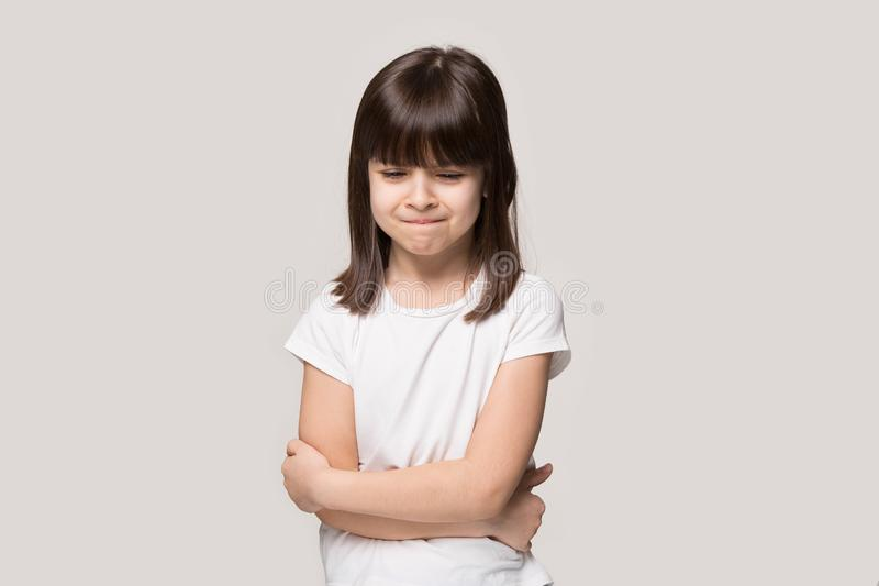 Frustrated upset lonely little girl isolated on grey studio background royalty free stock photo