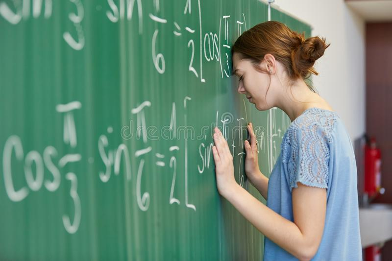 Frustrated woman as student stock images