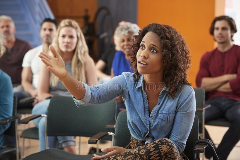 Frustrated Woman Asking Question At Group Neighborhood Meeting In Community Center royalty free stock photography