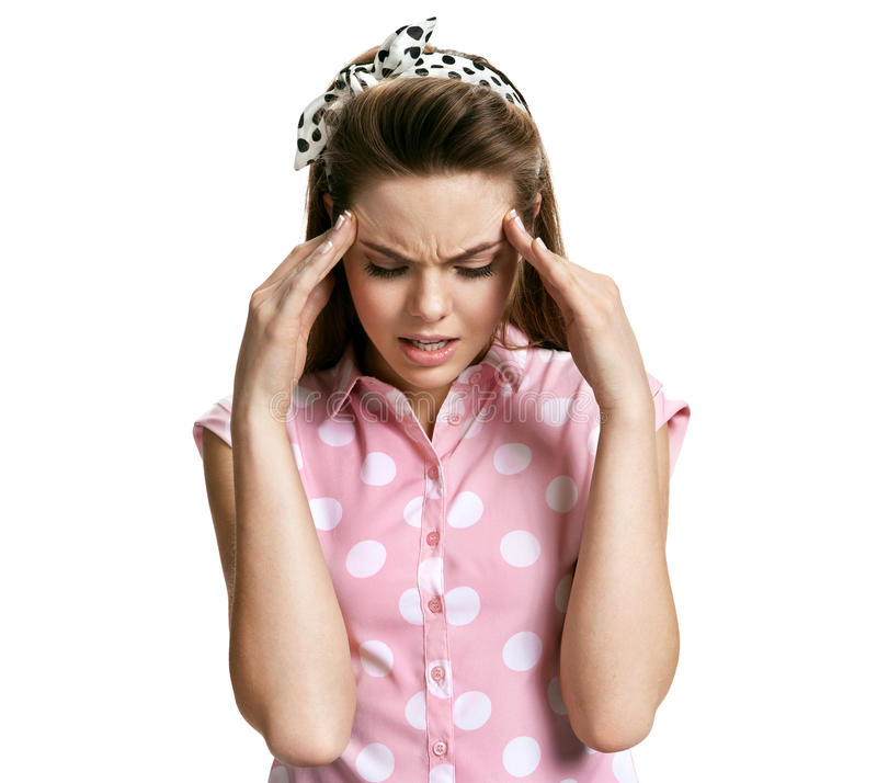 Frustrated woman with a headache stock photo