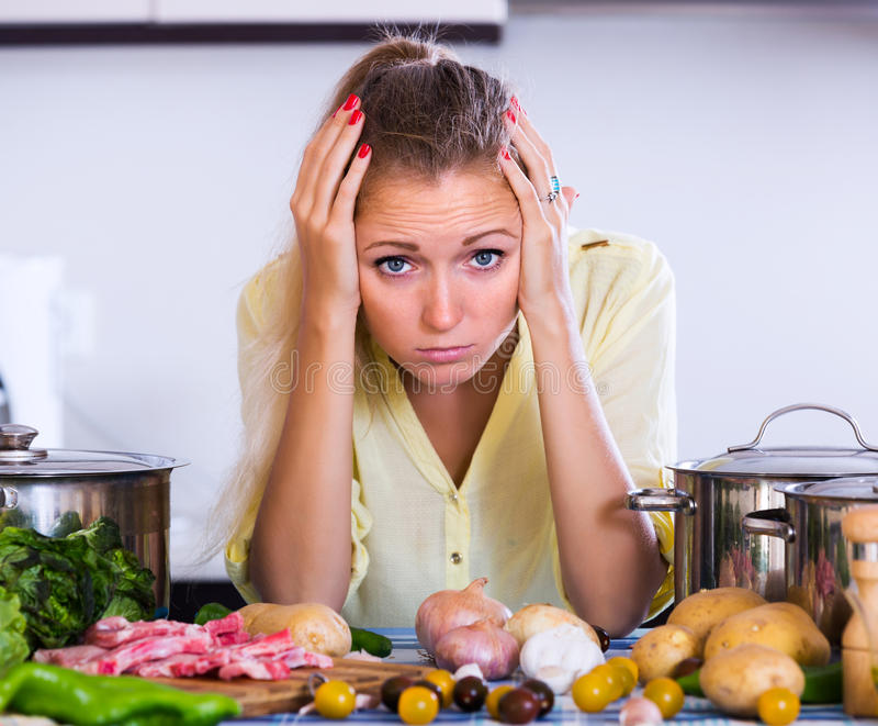 Frustrated woman looking at ingredients royalty free stock images