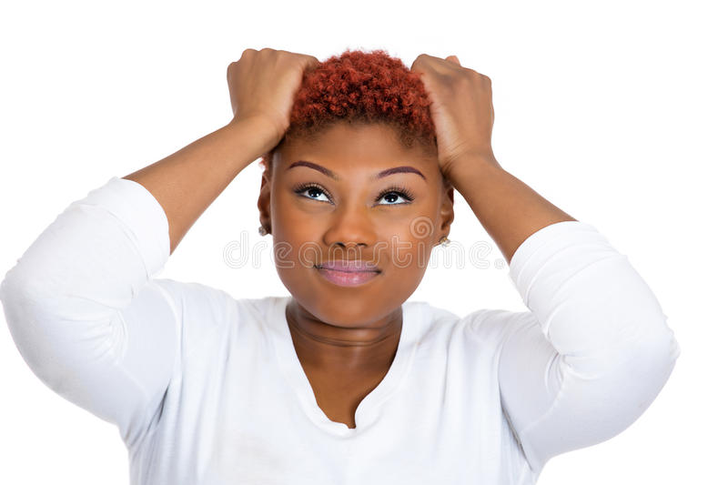 Frustrated woman pulling her hair out, having bad headache, stressed royalty free stock image