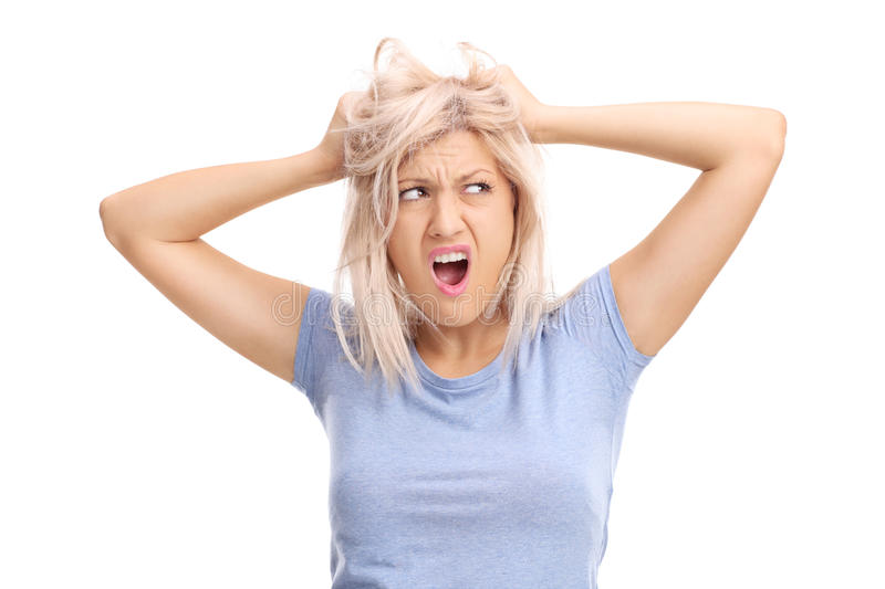 Frustrated woman pulling her hair and screaming royalty free stock photos