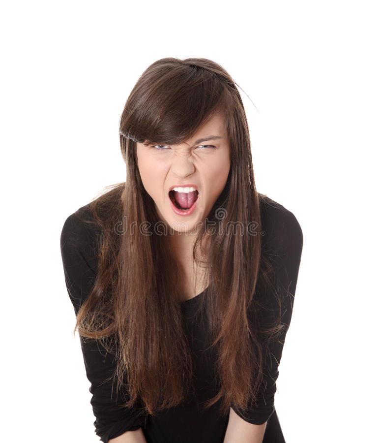 A Frustrated Woman Is Screaming Out Loud. Royalty Free Stock Photography