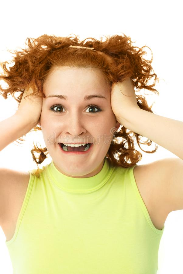 Frustrated woman tearing her hair royalty free stock photo