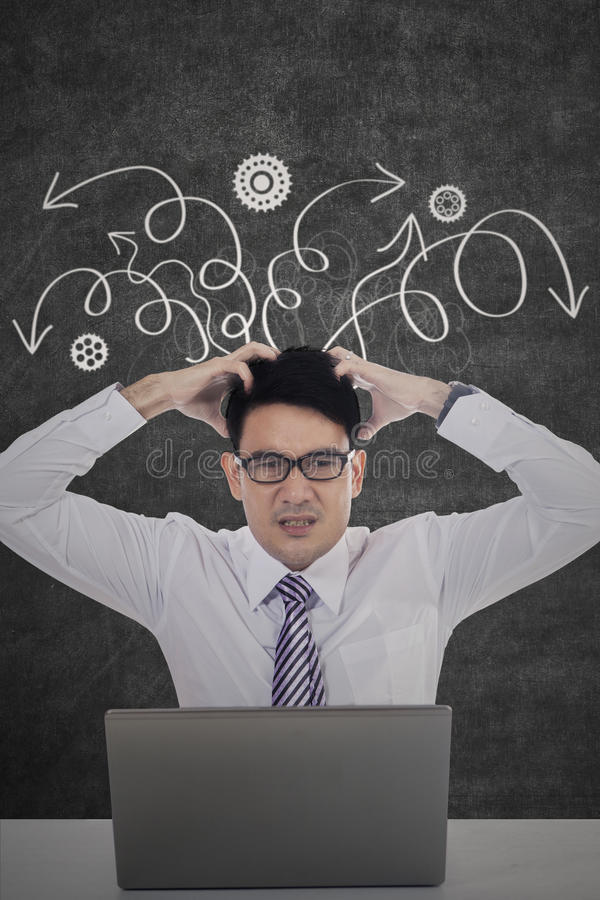 Frustrated worker scratching head royalty free stock images
