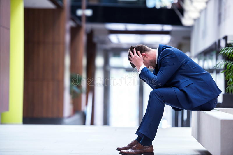 Frustrated young business man stock image