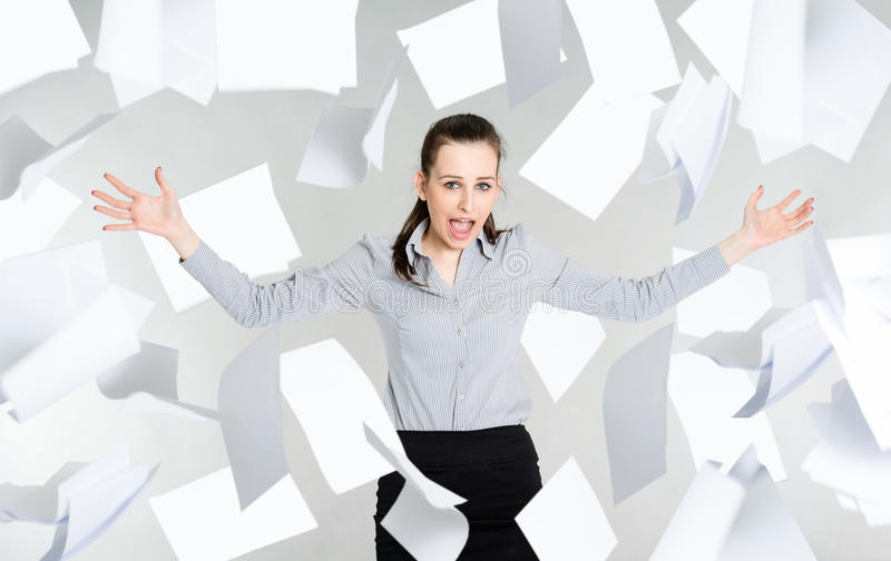 Download Desperate Businesswoman With Falling Paper Documents Stock Image - Image: 30037749