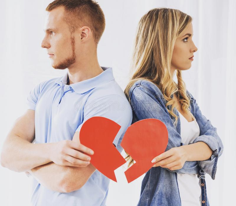 Frustrated Young Couple Holding Broken Heart. royalty free stock photos