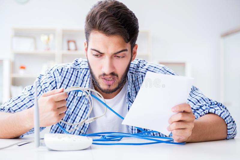 The frustrated young man due to weak internet reception stock images