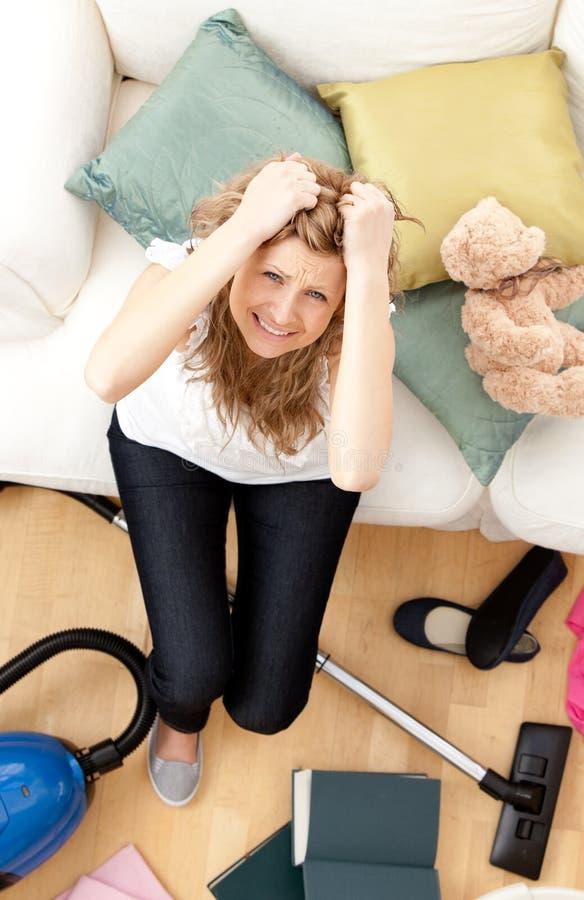 Frustrated young woman doing housework stock photos