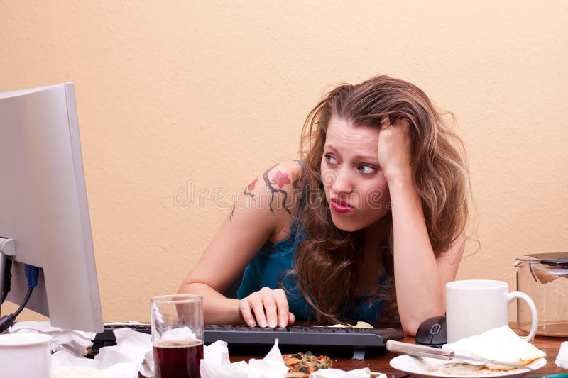 Frustrated Young Woman Is Sitting In Front Of The Monitor Stock Photos