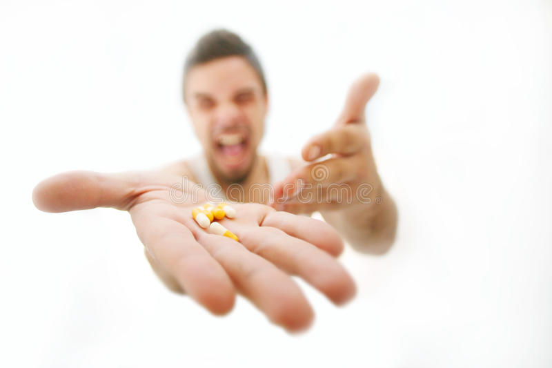 Frustration. Pills in palm man screaming