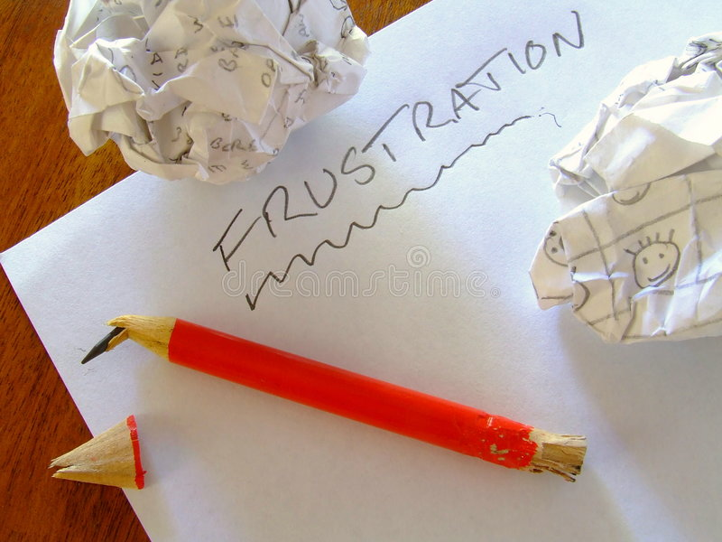 Frustration /B. Sheet of paper with frustration scrawled on it. Pencil with broken point and chewed end. Crumpled balls of paper stock photography
