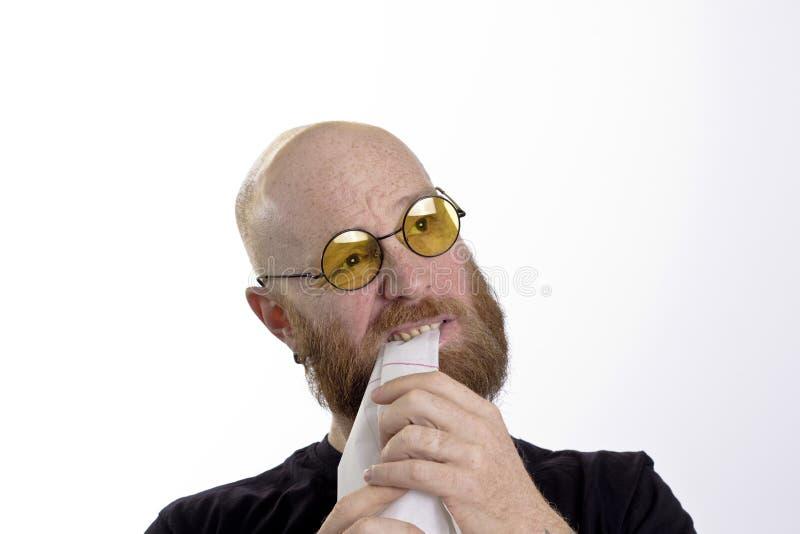 Frustration, man eating paper royalty free stock photos