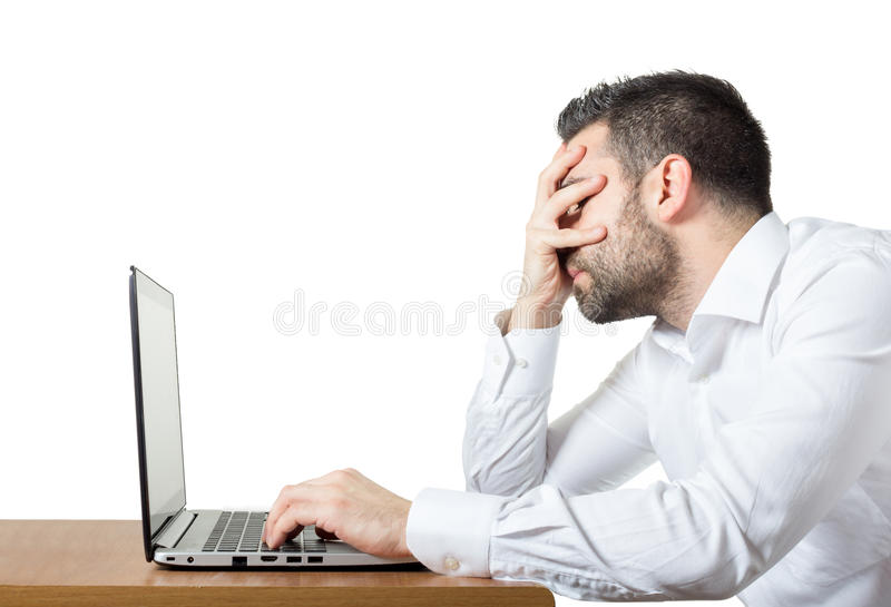 Frustration at work. Businessman having issues with laptop and/or office stock photo