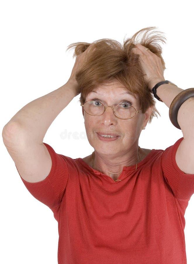 frustrerad hög kvinna arkivbild