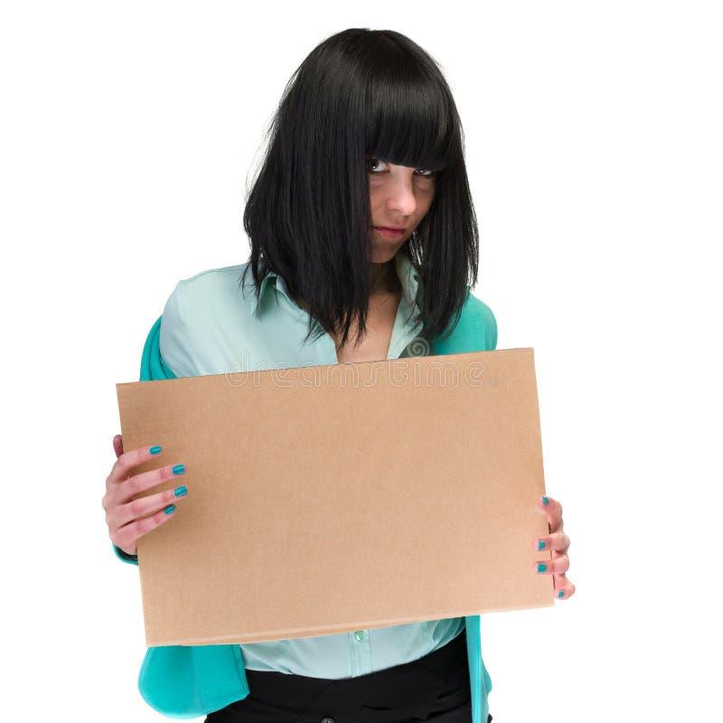 Frustrerad papp för mellanrum för visning för affärskvinna arkivfoto