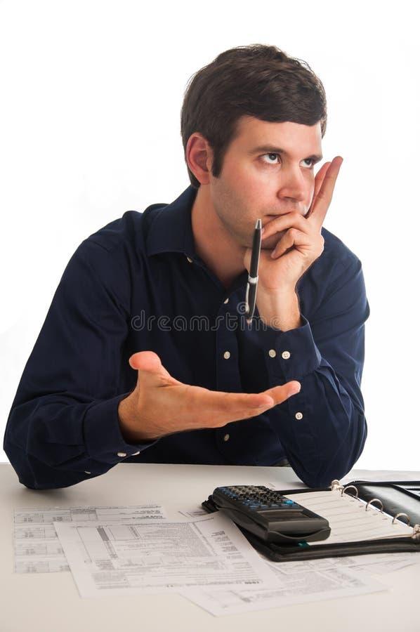 Frustriert durch Taxes lizenzfreie stockbilder