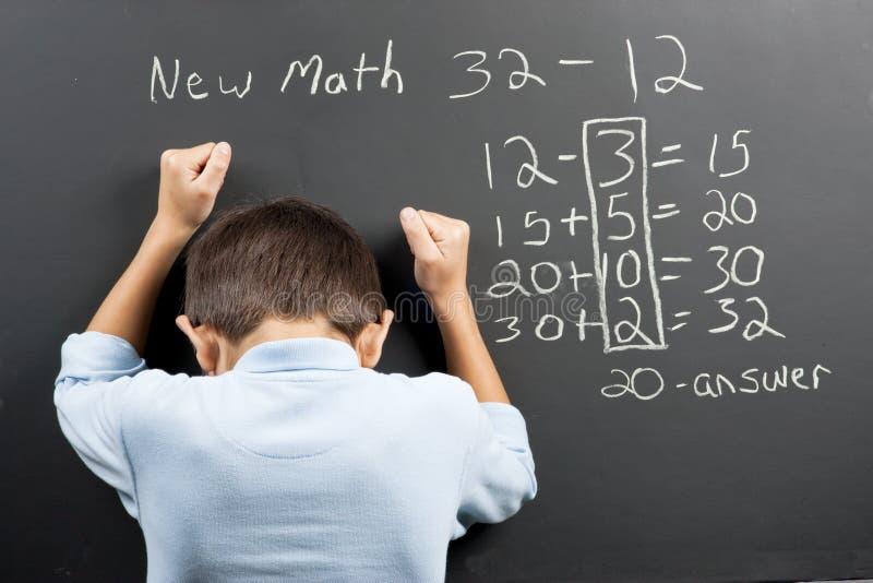 Frustriert an neuen Mathe lizenzfreie stockbilder