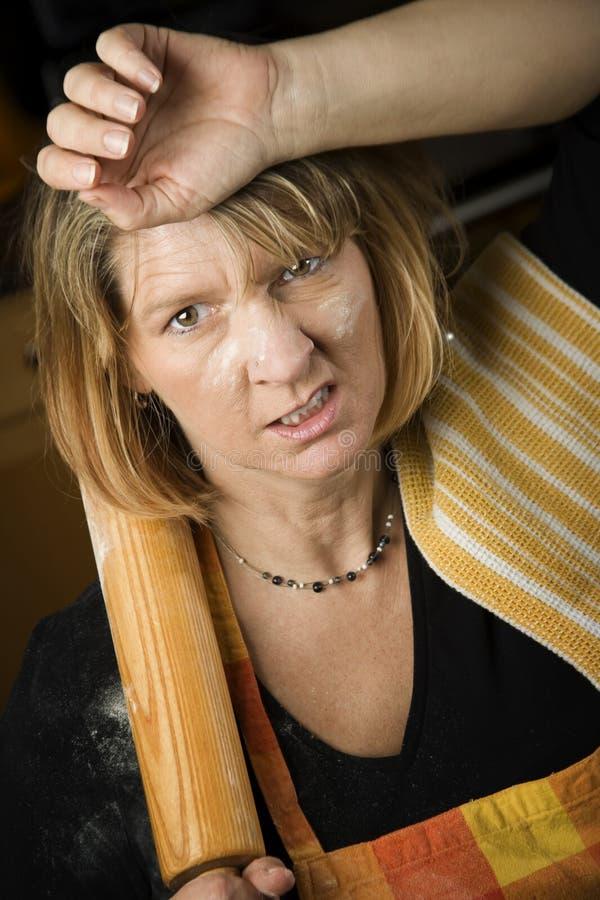 Frustrierter Frauen-Bäcker stockbild